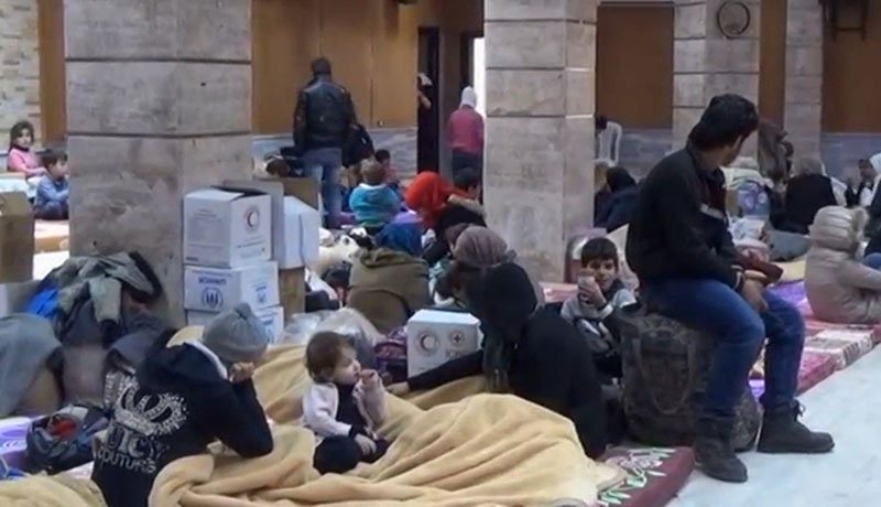 A still image taken from a video obtained by Reuters, said to be shot on January 4, 2017, shows civilians, who were evacuated from Wadi Barada, sitting inside a shelter in the Damascus suburb of Rawda, Syria.