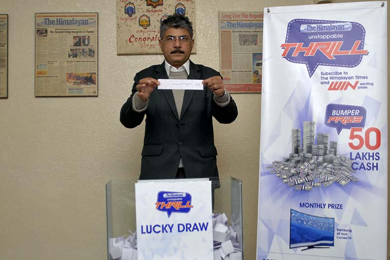 Editor of The Himalayan Times Prakash Rimal draws the winning numbers of THT's subscription campaign. Photo: THT