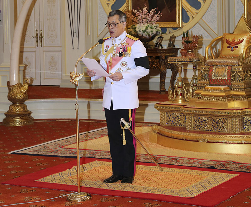 FILE - Thailand 's new King Maha Vajiralongkorn Bodindradebayavarangkun delivers a speech after accepting the throne at the Dusit Palace in Bangkok, Thailand, on Thursday, December 1, 2016. Photo: Bureau of the Royal Household via AP