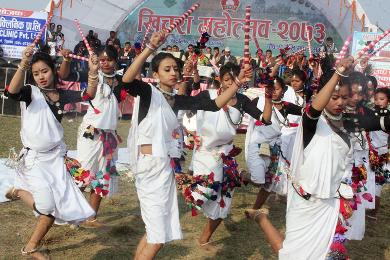 Members of Tharu community clad in their traditional attires perform a dance on the occasion of Khichara Festival in Khaireni of Chitwan district, on Thursday, January 12, 2017. Photo: RSS