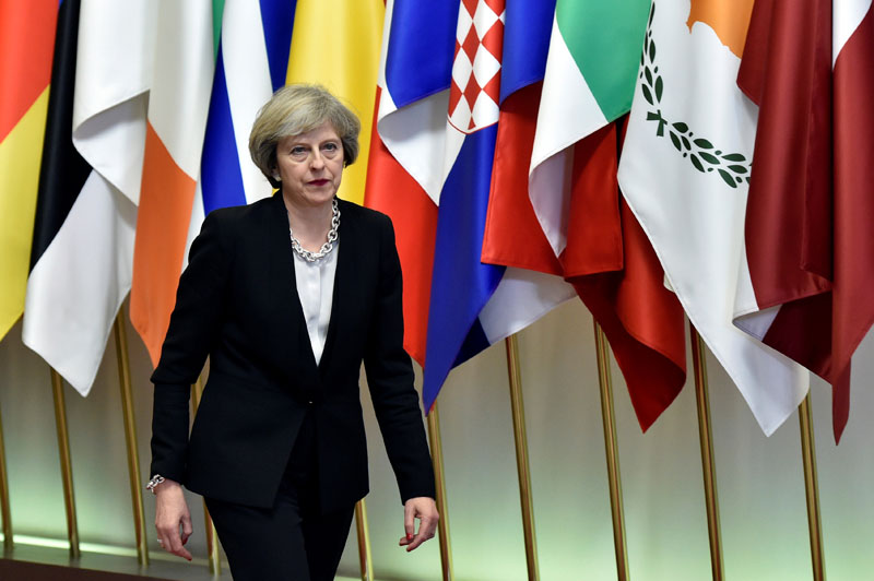 Britain's Prime Minister Theresa May leaves a EU Summit at the European Council headquarters in Brussels, Belgium, on December 15, 2016. Photo: Reuters