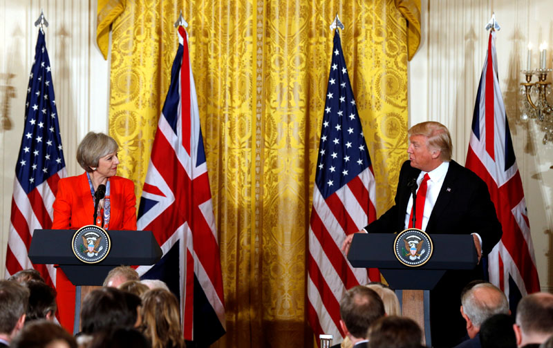 British Prime Minister Theresa May and US President Donald Trump gesture towards each other during their joint news conference at the White House in Washington, US, on January 27, 2017. Photo: Reuters