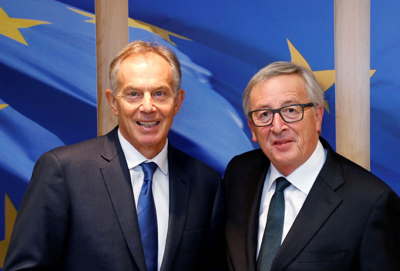European Commission President Jean-Claude Juncker poses with former British Prime Minister Tony Blair (left) ahead of a meeting at the EU Commission headquarters in Brussels, Belgium, on  January 25, 2017. Photo: Reuters