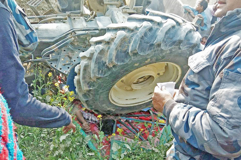 A youth is seen crushed under a tractor in Samanpur of Rautahat district, on Saturday, January 14, 2017. Photo: Prabhat Kumar Jha