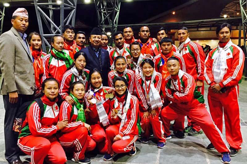 Wushu players with CoAS Gen Rajendra Chhetri (centre) and Lt Col Ram Kaji Rana Magar after the felicitation programme in Kathmandu on Sunday, January 8, 2017. Photo: THT