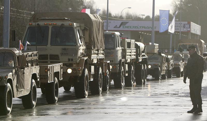 US Army vehicles cross the Polish border in Olszyna, Poland, Thursday, Jan. 12, 2017 heading for their new base in Zagan. Photo: AP