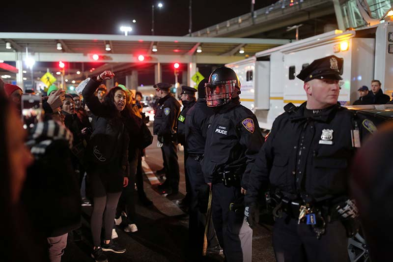 Protesters gather outside Terminal 4 at JFK airport in opposition to US president Donald Trump's proposed ban on immigration in Queens, New York City, US, on January 28, 2017. Photo: Reuters