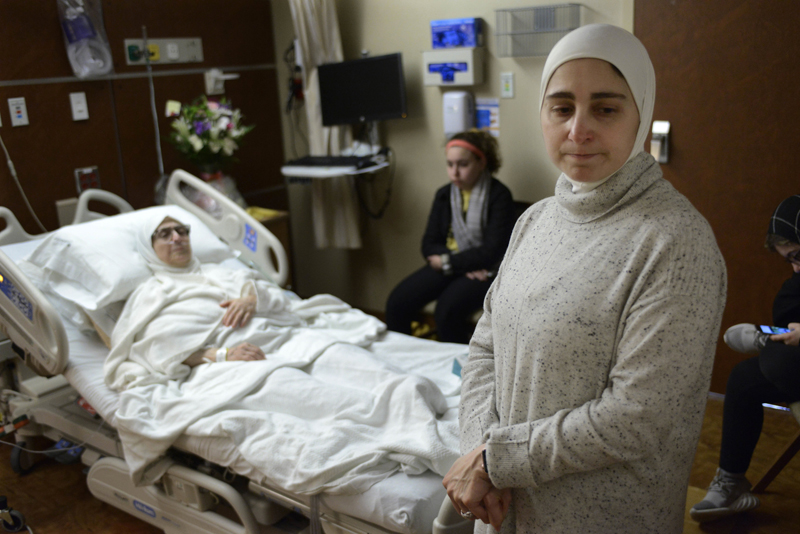 Nour Ulayyet foreground, looks on after her sister Sahar Algonaimi was not permitted to enter the United States while comforting her mother Isaaf Jamal Eddin at Munster Community Hospital Saturday, Jan. 28, 2017, in Munster, Ind. Photo: AP