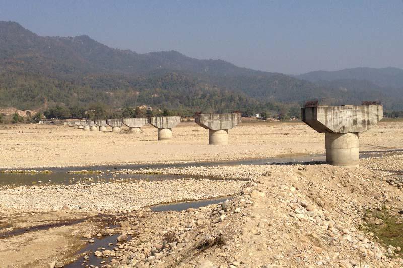 An under-construction bridge over the Kamala River in Sindhuli district, on Monday, January 30, 2017. Photo: Min Kumar Dahal