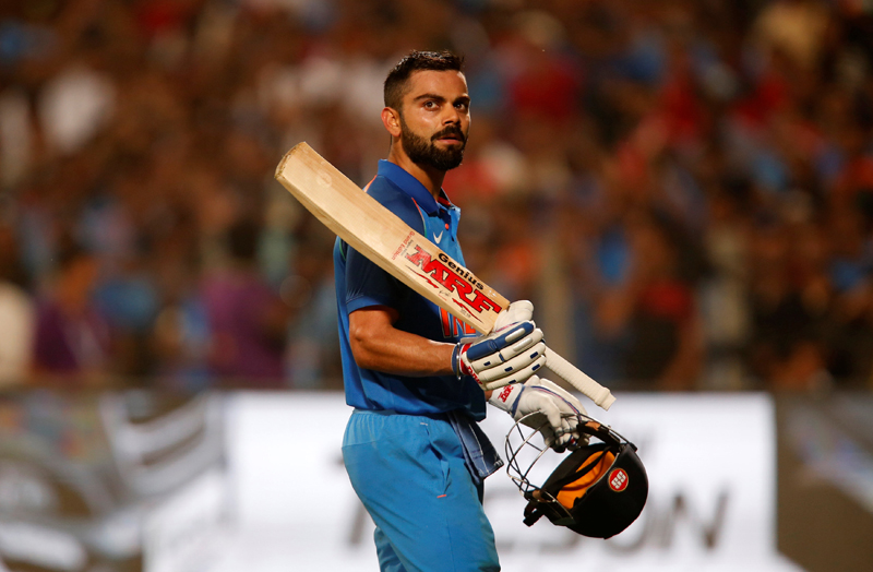 India's captain Virat Kohli acknowledges the crowd as he walks off the ground after being dismissed. Photo: Reuters