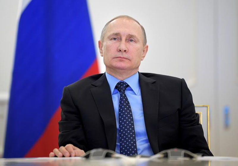 Russian President Vladimir Putin takes part in a video link, dedicated to the start of natural gas supplying from mainland Russia to Crimea, in Moscow, Russia, December 27, 2016. Photo: Sputnik via Reuters