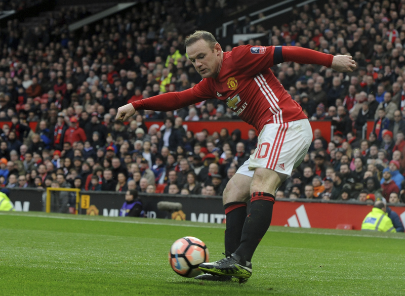 Manchester United's Wayne Rooney shoots at goal during the English FA Cup Third Round match between Manchester United and Reading at Old Trafford in Manchester, England, Saturday, Jan. 7, 2017. Photo: AP