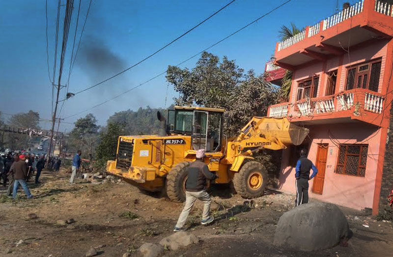 A dozer demolishing an illegally constructed building in Hetauda, Makawanpur, on Tuesday, January 17, 2017. Photo: THT