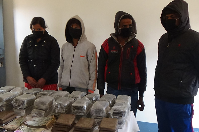 Four drug smuggling suspects, who were arrested from Simle, Bhumesthan along the Prithvi Highway, being paraded at the District Police Office in Dhading, on Wednesday, January 11, 2017. Photo: Keshav Adhikari