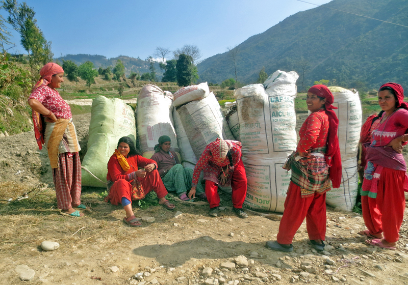 Women take a breather after collecting fodders from a nearby forest, in Ugrachandi Nala of Kavre district, on Thursday, January 12, 2017. Photo: RSS