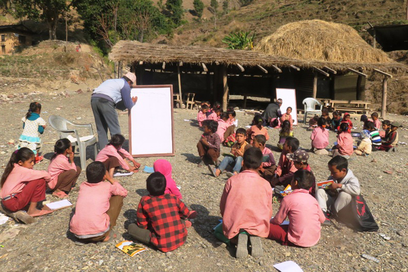 Students of the Janata Primary School in Pipalchaur, Lahan-4 of Jajarkot district study in the open for want of a building, on Sunday, January 17, 2017. The school building was swept away by a flood seven months ago. Photo: Dinesh Kumar Shrestha