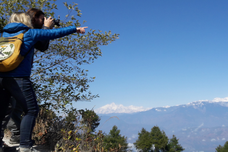 Tourists take pictures of various mountains from Kakani of Nuwakot district, on Saturday, January 28, 2017. Photo: Prakash Singh