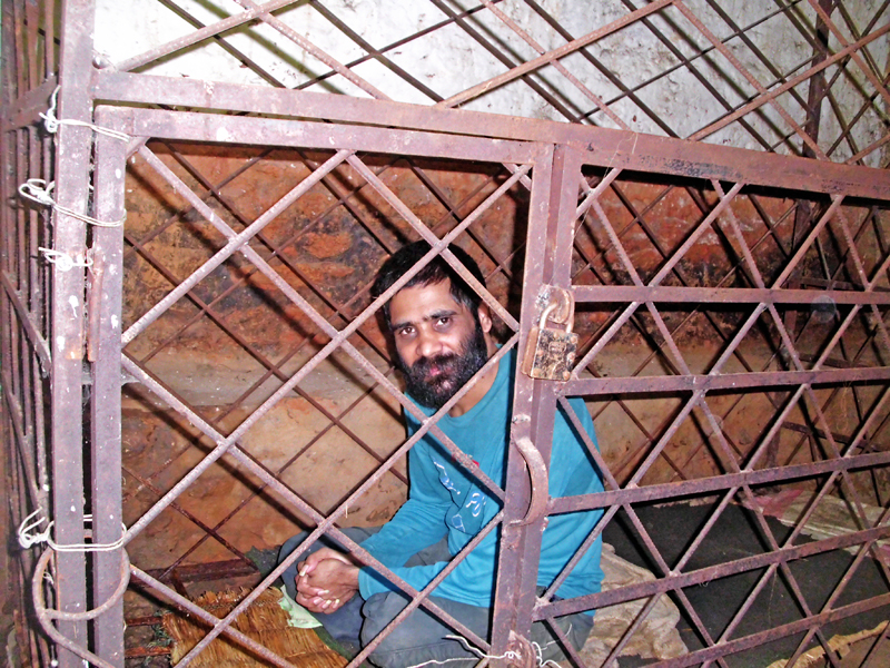 Udaya Narayan Dahal, a mental patient, inside an iron cage, in Bohim, Tehrathum, on Friday, January 13, 2017. Photo: THT