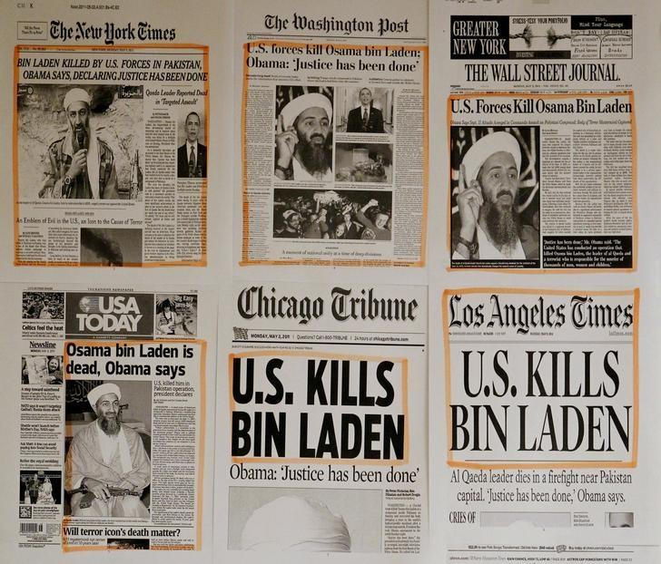 Newspaper headlines and clippings are posted on a wall inside a staff office at the White House in Washington May 2, 2011, the morning after U.S. President Barack Obama announced the death of Osama bin Laden.     REUTERS/Jason Reed/Files