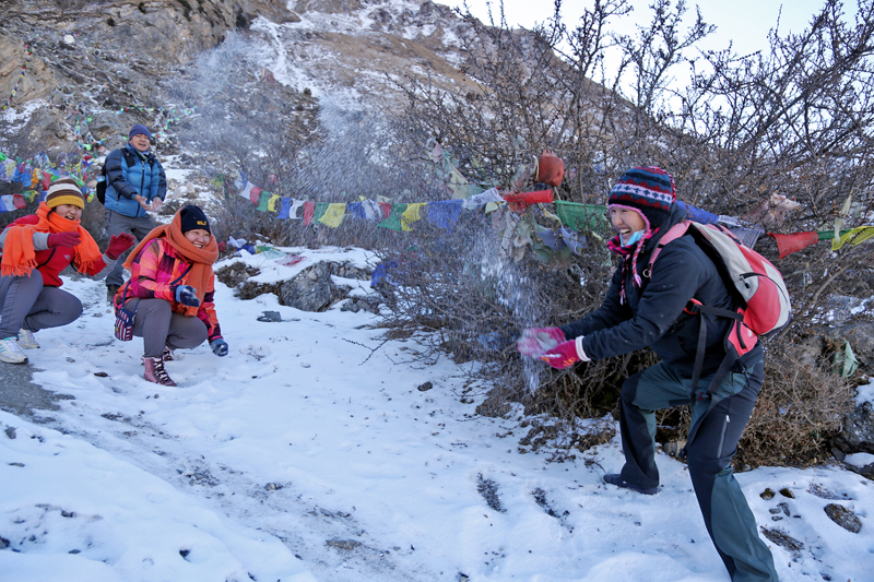 Tourists play with snow near the Muktinath Temple in Mustang district, on Sunday, January 15, 2017. Photo: RSS