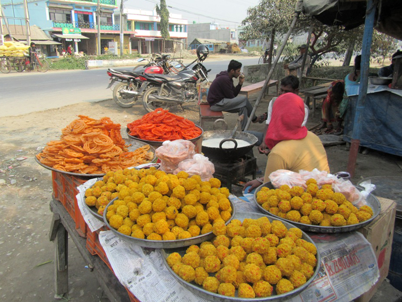 Sweets are being sold in the open on a roadside at Pakali Chok of Itahari in Sunsari district, on Tuesday, January 10, 2017. Photo: RSS