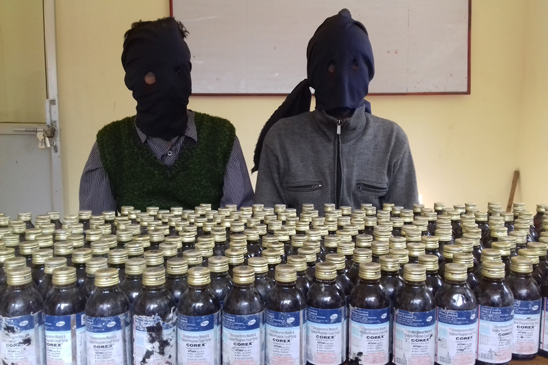 The Saptari District Police Offices makes two persons arrested in possession of 300 bottle illegal corex public, in Rajbiraj of the district, on Wednesday, January 18, 2017. Photo: Byas Shankar Upadhyaya