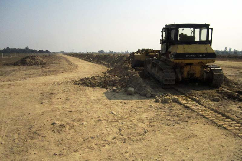A bulldozer flats the land for the under-construction Rajbiraj Airport, which had been in limbo for long, in Rajbiraj on Monday, January 9, 2017. Photo: THT