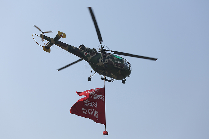 A helicopter exhibits a banner of the Democracy Day 2017 during the function organised to mark the 67th Democracy Day at the Army Pavilion in Tundikhel, Kathmandu, on Saturday, February 18, 2017. Photo: RSS