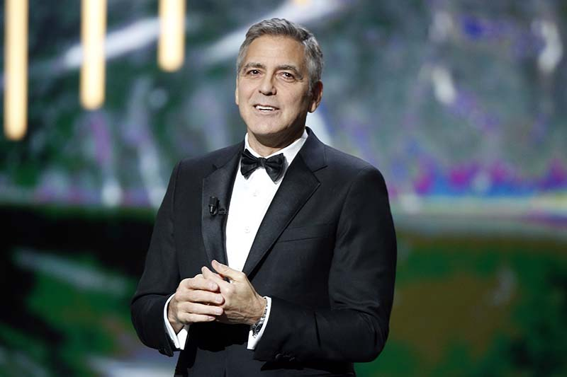Actor George Clooney reacts on stage as he received an Honorary Cesar award during the 42nd Cesar Film Awards ceremony at Salle Pleyel in Paris, on Friday, February 24, 2017. Photo: AP