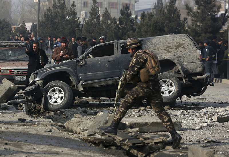 FILE - Afghan security personnel inspect the site of roadside bomb blast in Kabul, Afghanistan, on Wednesday, December 28, 2016. Photo: AP