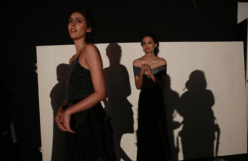Anjali Lama (right) waits backstage for her turn to walk the ramp during Lakme Fashion week in Mumbai, India, on February 1, 2017. Photo: AP