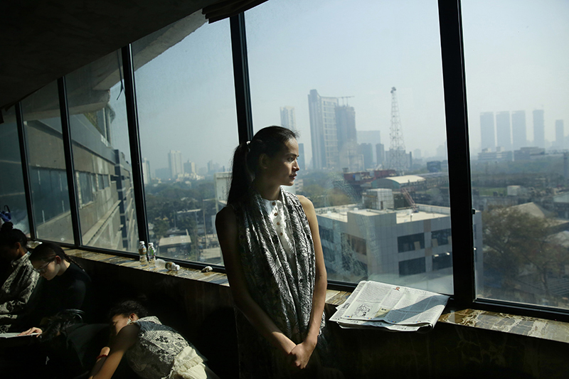Anjali Lama looks out of a window of a hotel during a trial event for Lakme Fashion week in Mumbai, India, on  Jan 30, 2017. Photo: AP