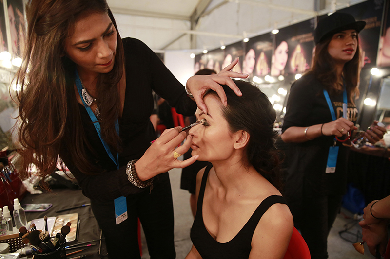 A makeup artist applies eye-shadow on Anjali Lama during Lakme Fashion week in Mumbai, India, on February 1, 2017. Photo: AP