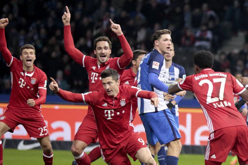 Bayern Munich players celebrate Robert Lewandowski's goal v Hertha Berlin. Photo: Reuters