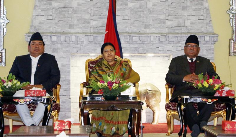 Nepal's President Bidya Devi Bhandari (centre) along with Vice-President Nanda Bahadur Pun (left) and Prime Minister Pushpa Kamal Dahal attend a major seven parties meeting at latter's office Sheetal Niwas in Kathmandu, on Monday, February 13, 2017. Photo: RSS