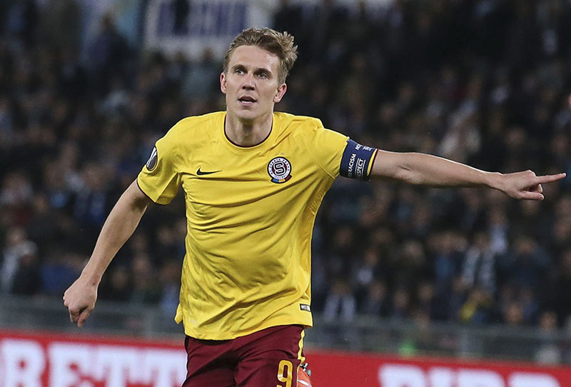 FILE- Sparta Prague's Borek Dockal celebrates after scoring his side's opening goal during the Europa League, round of 16, second-leg soccer match between Sparta Prague and Lazio, at Rome's Olympic stadium, on Thursday, March 17, 2016. Photo: Alessandro Di Meo/ANSA via AP