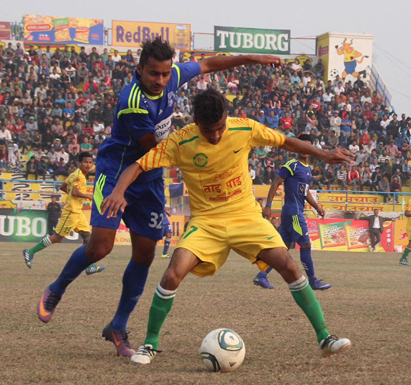 Nepal Police Club's Ajit Bhandari (left) vies for the ball with Dharan Football Clubu2019s player during their Budha Subba Gold Cup match in Dharan on Friday, February 17, 2017. Photo: THT