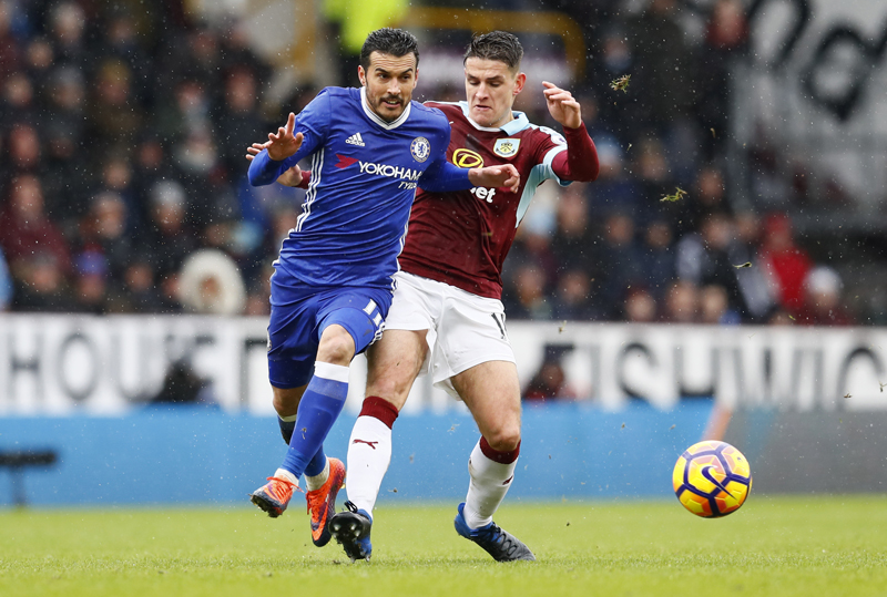 Chelsea's Pedro in action with Burnley's Ashley Westwood. Photo: Reuters