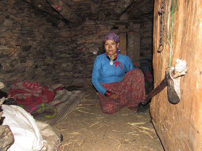 A new mother living in a Chhaupadi hut in Rugin VDC, Bajura, on Wednesday, February 22, 2017. Photo:THT
