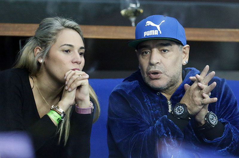 FILE - Former soccer player Diego Maradona of Argentina sits with his companion Rocio Oliva watching the Davis Cup finals tennis match in Zagreb, Croatia, on November 25, 2016. Photo: AP