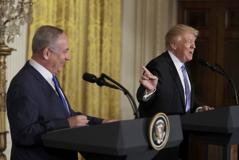 US President Donald Trump (right) laughs with Israeli Prime Minister Benjamin Netanyahu at a joint news conference at the White House in Washington, US, on February 15, 2017. Photo: Reuters
