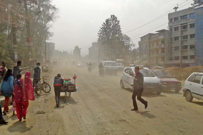 Commuters are seen heading to their destination though cloud of dust along Gopikrishna-Chahabil road section in Kathmandu, on Tuesday, February 28, 2017. Photo: RSS