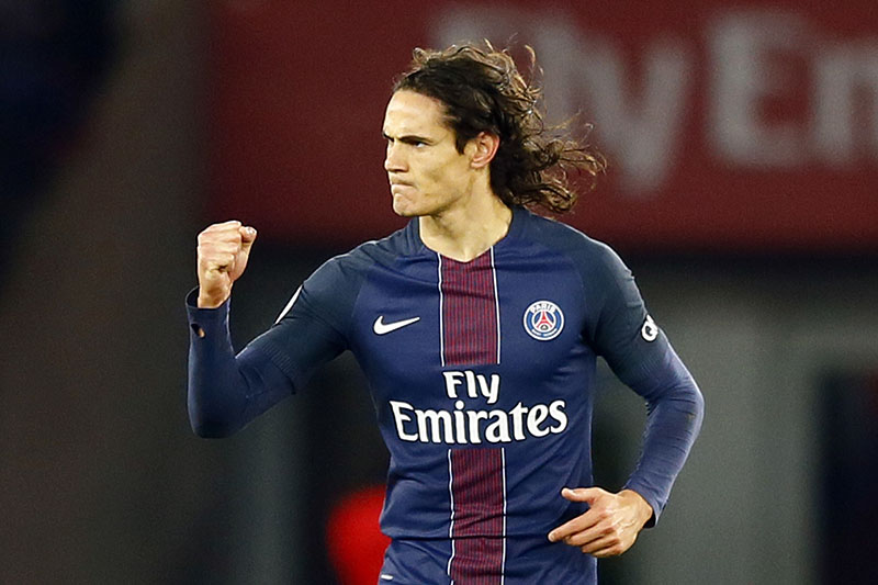 FILE-  PSG's Edinson Cavani reacts after their first goal during their French League One soccer match between PSG and Marseille at the Parc des Princes stadium in Paris, France, on Sunday, November 6, 2016. Photo: AP