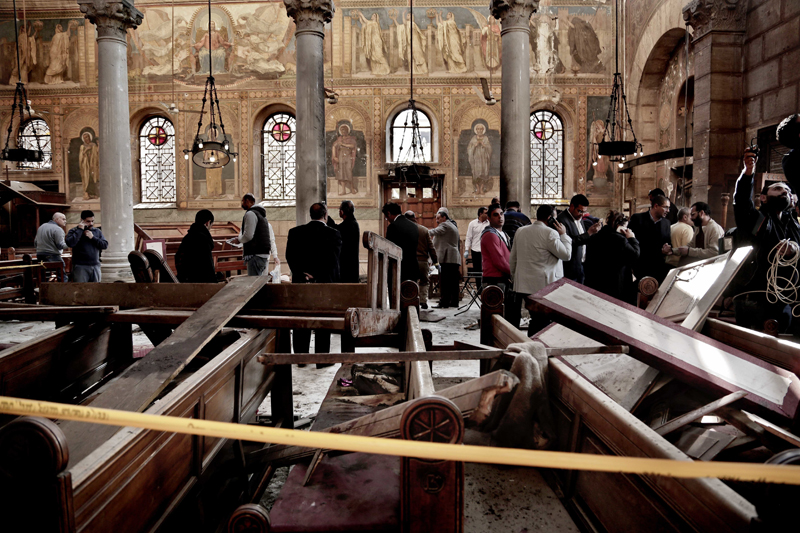 FILE -- In this Dec. 11, 2016 file photo, security forces examine the scene inside the St. Mark Cathedral in central Cairo, following a bombing that killed dozens of people. Photo: AP