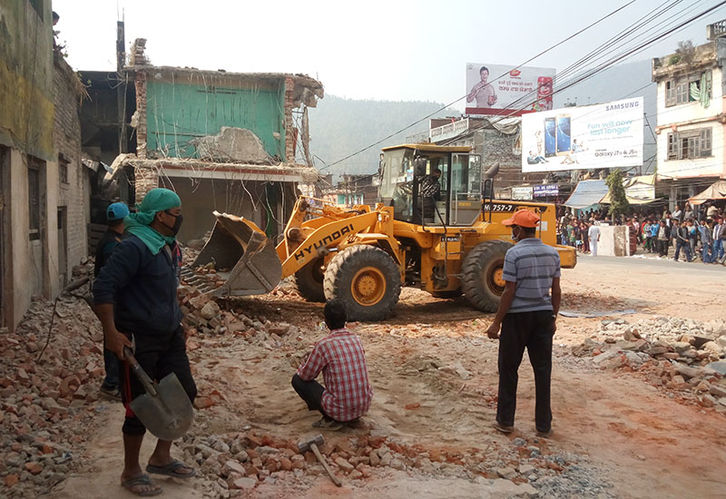 Demolition of infrastructure built by encroaching the road along the  East-West Highway in progress, in Hetauda, Makawanpur, on Monday, February 20, 2017. Photo: THT