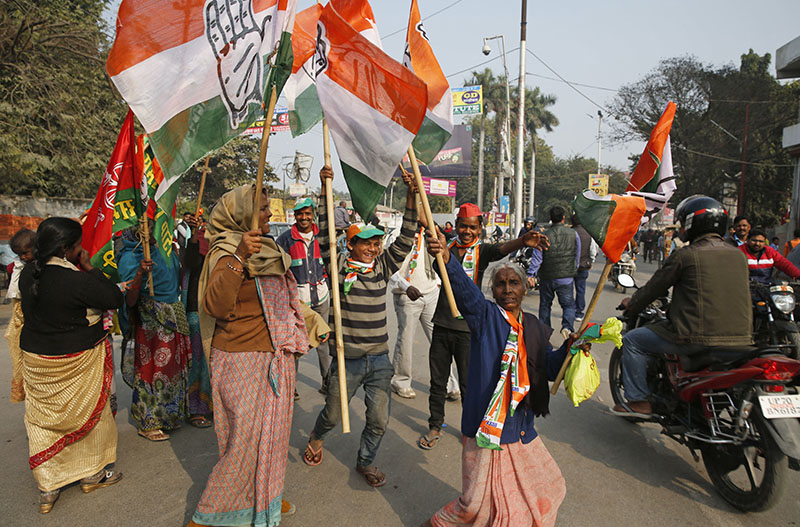 The Congress party and their ally Samajwadi Party supporters dance with party flags as their candidate files nomination papers in Allahabad, in the northern Indian state of Utter Pradesh, on February 2, 2017. Photo: AP