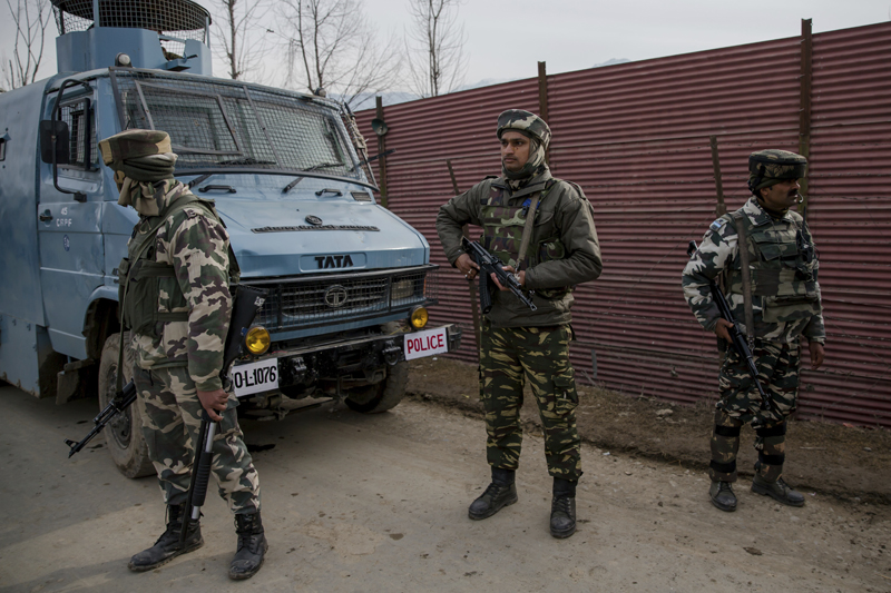 Indian paramilitary soldiers stands guard outside a base camp near the site of a gun battle with suspected rebels in Hajin Village some 38 kilometers (23.75 miles) northeast of Srinagar, Indian controlled Kashmir, Tuesday, Feb. 14, 2017. Photo: AP