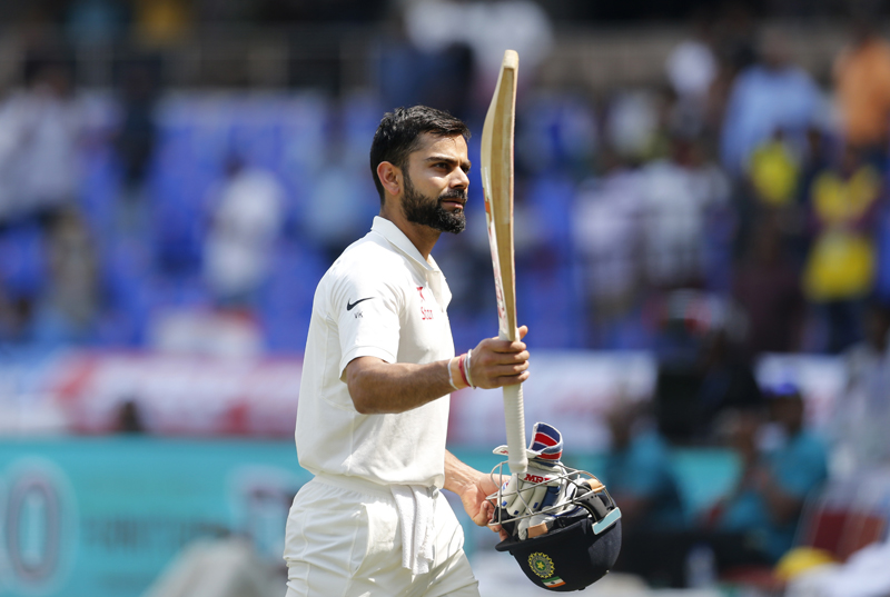 India's captain Virat Kohli raises his bat to acknowledge the applause from the crowd. Photo: AP