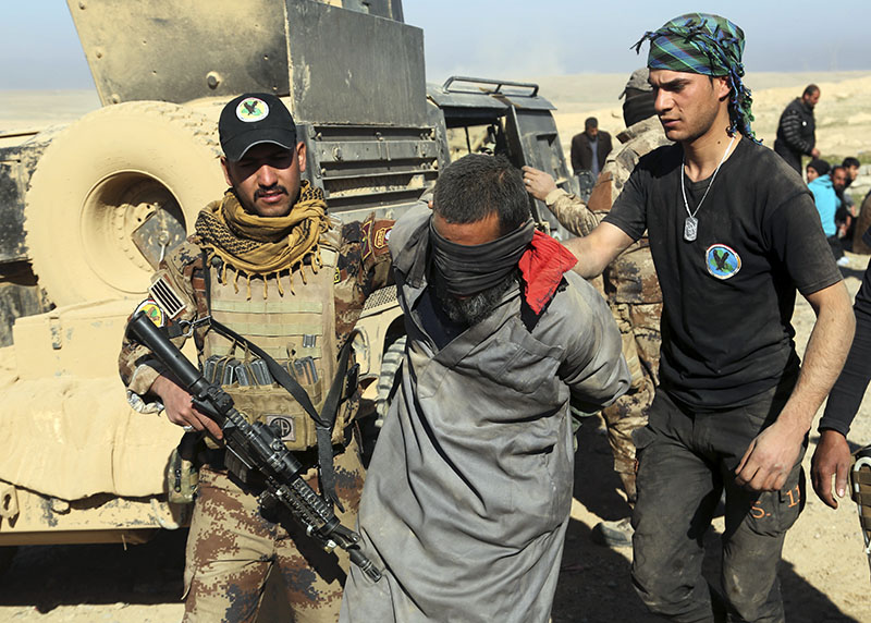 n    Iraqi special forces arrest a fighter with Islamic State militia in Mosul, Iraq, on Saturday, February 25, 2017. Photo: AP