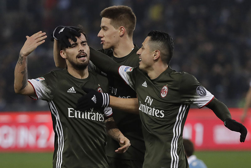 AC Milan's Suso (left) celebrates with teammates after scoring a goal during an Italian Serie A soccer match between Lazio and Milan, at the Olympic stadium in Rome, on Monday, February 13, 2017. Photo: AP